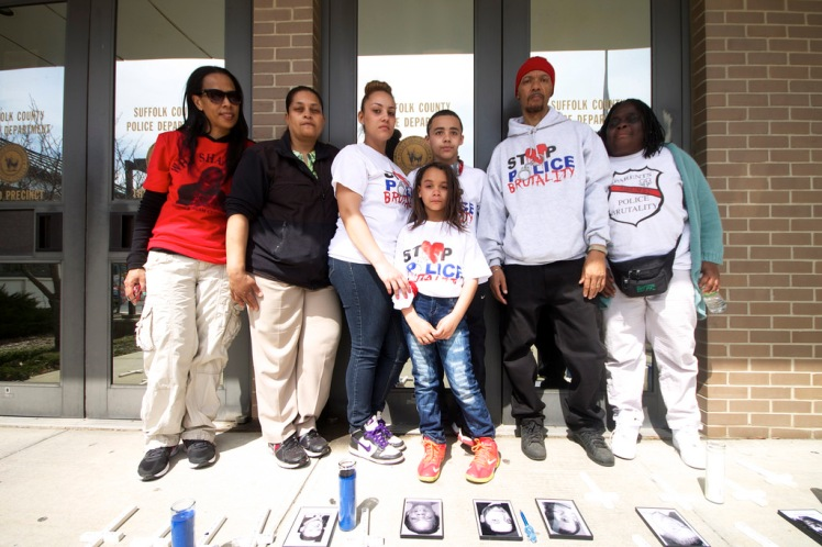 Family members of Stolen Lives (killed by Law Enforcement) gathered together on April 12th, 2014, for the Annual Anti-Police Brutality March in Long Island/6th Anniversary of Kenny Lazo's police murder, in front of the Suffolk County Police Department, 3rd Precinct. From left to right, Ang Hicks, aunt of Shantel Davis, Cynthia Howell, niece of Alberta Spruill, Jennifer Gonzalez, partner of Kenny Lazo, Kenny Lazo, son of Kenny Lazo, (in front) Elliana Tavarese, sister of Kenny Jr./daughter of Jennifer Gonzalez, Nicholas Heyward, father of Nicholas Heyward Jr., Juanita Young, mother of Malcolm Ferguson.