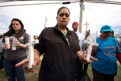 Cynthia Howell, niece of Alberta Spruill, killed by NYPD, holds white crosses representing Long Island Stolen Lives, Annual Anti-Police Brutality March in Long Island, April 12th, 2014, Bay Shore, New York.