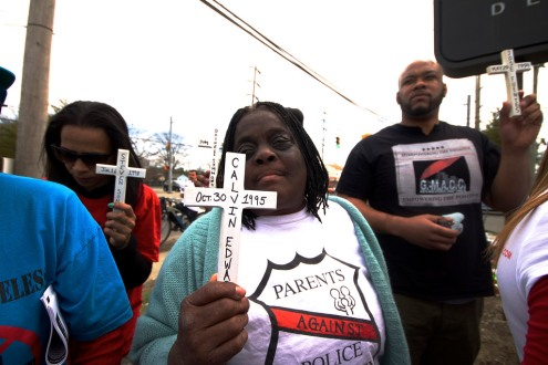 Juanita Young, mother of Malcolm Ferguson, killed by NYPD, stands with others, holding up the crosses that represent Long Island Stolen Lives, killed by law enforcement. Annual Anti-Police Brutality March in Long Island, April 12th, 2014, Bay Shore, New York.