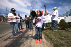 Elliana (daughter of Jennifer Gonzalez and sister of Kenny Lazo Jr.) leads the chants This year Justice for Kenny Coalition fundraised to rent a bus to bring New York City supporters to and from Long Island. In just two weeks time, the bus was completely filled, Annual Anti-Police Brutality March in Long Island, April 12th, 2014, Bay Shore, New York.