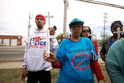 Nicholas Heyward, Sr., father of Nicholas Heyward, Jr. (shot and killed by New York housing cop, Brian George in 1994), Kendall Jackman of Picture the Homeless, and Angie Hicks stand with the crosses representing Stolen Lives, killed by law enforcement. Annual Anti-Police Brutality March in Long Island, April 12th, 2014, Bay Shore, New York.