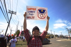 NYC Activist Geronimo holds up a sign. Annual Anti-Police Brutality March in Long Island, April 12th, 2014, Bay Shore, New York.