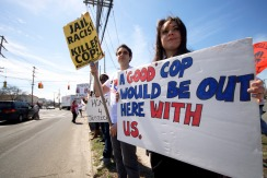 Protestors from New York City hold up signs demanding those responsible for Police Brutality to be held accountable at the Annual Anti-Police Brutality March in Long Island, April 12th, 2014, Bay Shore, New York.