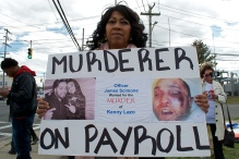 Patricia Gonzalez, mother of Kenny Lazo holds a sign demanding justice for her son. Annual Anti-Police Brutality March in Long Island, NY, Bay Shore, April 13th, 2013.