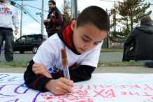 Kenny Jr., writing on the banner. Annual Anti-Police Brutality March in Long Island, NY, Bay Shore, April 13th, 2013.
