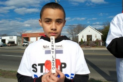 Kenny Jr. holding a cross for his father, Annual Anti-Police Brutality March in Long Island, NY, Bay Shore, April 13th, 2013.